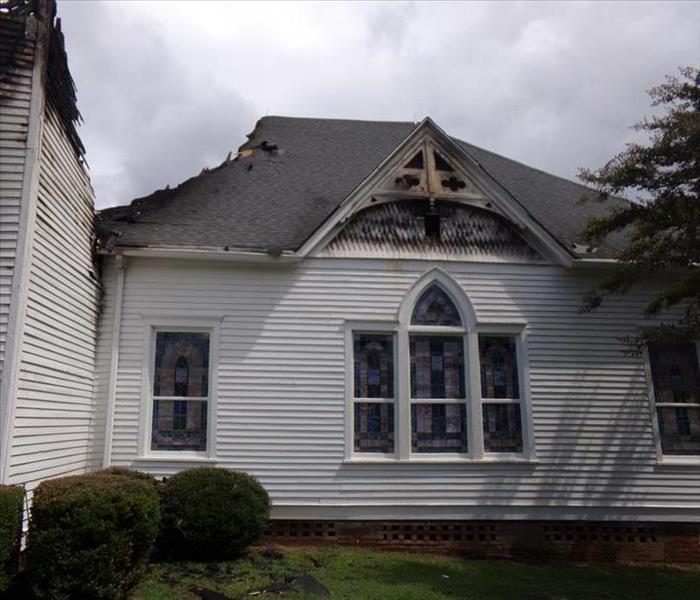 white church with damage