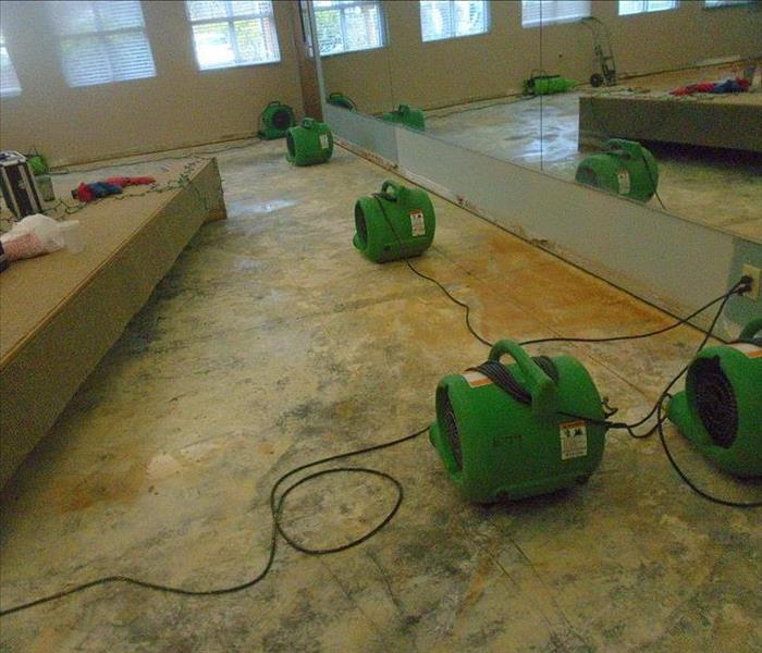 room with concrete floor and green equipment