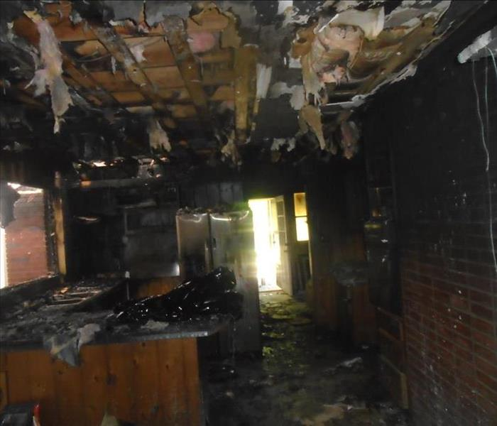room with brick wall and fire damage